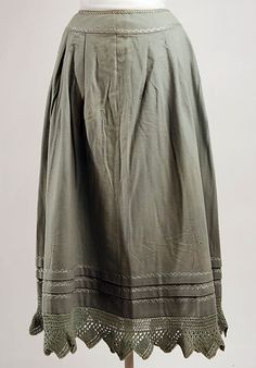 """Late 19th–early 20th century wool petticoat. The knitted lace at the border is the kind usually called """"vandyked"""" in knitting patterns from the 19th century. It's knit casting on stitches for the width. The points are formed by increasing stitches using yarnovers, and the casting off the same number of stitches on a single row. It looks like this one also involves a lot of garter stitch and faggoting (rows of yo and decreases to make a lacy, open fabric)."""