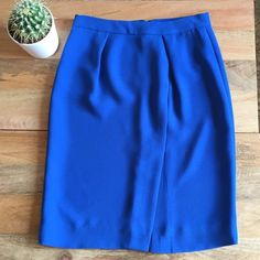 J.Crew Blue silk crepe skirt J.Crew silk crepe knee length pencil skirt with front side slit. Fully lined, hidden back zipper. Size 00, but would fit a 0 (waist 24-25) . In excellent condition, no flaws, only worn 2x for work, recently dry cleaned. Fabric feels like silk crepe, but tags say 100% poly. J. Crew Skirts Pencil