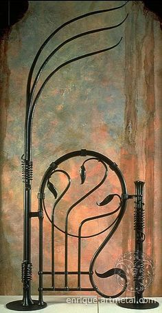 """Nouveau Style Garden Gate    Combining elements from nature, such as the contemporary floral and serpentine design elements, add a simple but unique flow to the overall design of this wrought iron gate. Finished with a burnt silver black coating and forged from solid steel as thick as 1 1/2"""", this wrought iron gate will long out last our generation. Size: 10' 6""""H (anchoring stems); 5'H x 3'W x 2""""T (gate); overall with is 4'"""