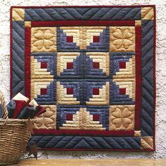 """Quilt Kits - Log Cabin Star Wall Hanging Quilt Kit - 22""""X22""""   I've never been excited by Log Cabin Quilts until I saw this one."""