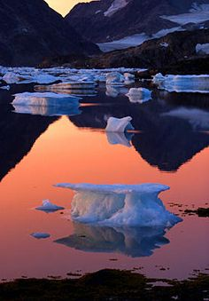 An iceberg floats in the bay in Kulusuk, Greenland near the arctic circle