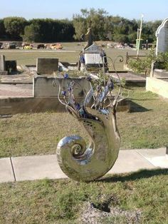 Unusual metalic sculpture as a grave marker