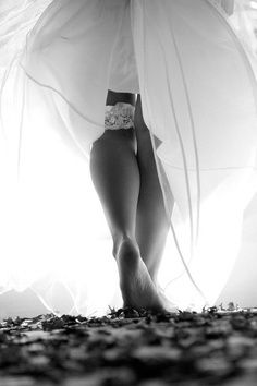Beautiful Photo. Garter, bride. Artistic black and white wedding photo.