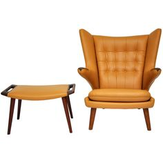 Hans Wegner Papa Bear Chair + Ottoman -- P. inherited one of these chairs & ottomans from his grandfather.  His is yellow, but fabric not leather.