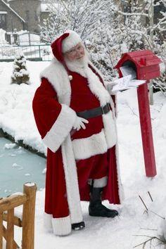 Ho, ho, ho.  Santa checks the mail box.