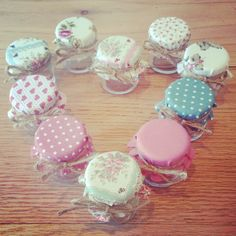 My own wedding favour jars I made with cute fabric covers perfect for whimsical, vintage rustic weddings love them =]