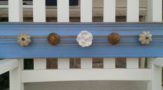 Repurposed wood Shabby chic vintage Jewelry organizer with 5 decorative knobs- necklace or accessories. $32.00, via Etsy.