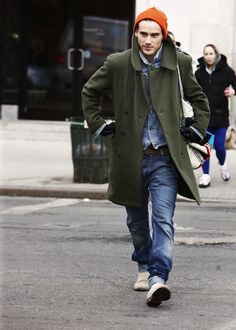 Orange Beanie, Green Coat, and Worn Out Jeans. Men's Fall Winter Street Style Fashion, NYC.