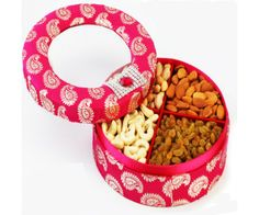A beautiful reusable Pink Satin Box containing best of cashews, almonds, raisons and Pistachios. Net Weight: 500 gms.