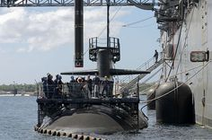 Guam (Nov. 16, 2012) Sailors and civil service mariners assigned to the submarine tender USS Frank Cable (AS 40) lower a Tomahawk cruise missile onto the Los Angeles-class fast-attack submarine USS Oklahoma City (SSN 723).