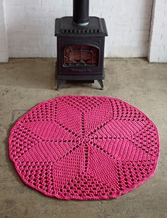 Brighten up your home with this fun hot pink rug, crocheted in Lily Sugar'n Cream. (Yarnspirations)