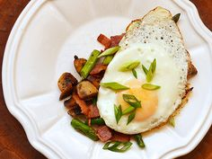 This play on hash uses the combination of earthy mushrooms, sweet asparagus, and thick cut bacon as the base for runny fried eggs