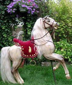 We are proud to show you one of our carousel horses. The former owners decided in 2003 to put him on rockers as a large rocking horse