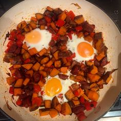 Spicy sweet potato and peppers with baked eggs