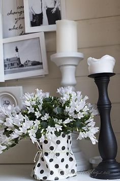 Spring mantel in black and white with a layered photo frame wall.