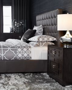 A bedroom with moody, modern appeal.