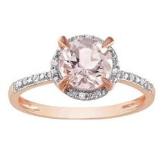 Morganite and White Diamond Engagement Ring stamped in 10k Rose Gold in a Prong setting featuring a Morganite Round cut center stone with White Round diamonds around the halo mount & shoulders of the shank - comes with a total gem weight of .05 carats. #unusualengagementrings