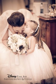 Could this photo be any sweeter? #Disney #wedding #flowergirl #bride