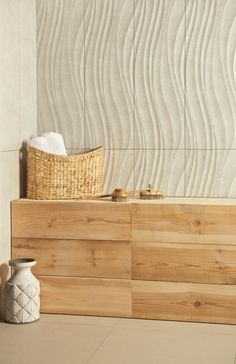 Co-ordinating plain and textured wave tiles, all with a matt finish.