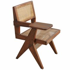 Pierre Jeanneret (Designer) COUNTRY:India DATE OF MANUFACTURE:1950s MATERIALS:cane, teak CONDITION:Excellent WEAR:Wear consistent with age and use HEIGHT:32 in. (81 cm) WIDTH:22.5 in. (57 cm) DEPTH:20.5 in. (52 cm) SEAT HEIGHT:17.75 in. (