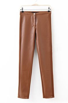 Skinny leggings crafted in PU, featuring a mid rise waistband with button closure, stitching to the leather look main, contrast stretch panel to both sides, in a bodycon fit.