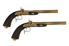 Pistols, French cased pair of rifled percussion pistols of presentation quality, decorated with elaborate gold-encrusted vine patterns, by Louis-Francois Devisme à Paris, dated 1852. Find this and other arms and armor at CuratorsEye.com.
