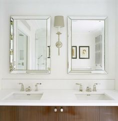 En suite bathroom - Mirrors, lamps and white marble