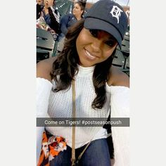 Model and Actress Teresa Alvarez sporting the Detroit Tigers baseball cap.  The hat is essential! Sweater by Fashion Nova.