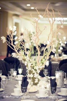 wedding centerpieces - the white/Green is awesome but minus the black. Maybe some dark green or emerald?