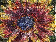 """""""Red Sunflower"""" by Susan Bianchi, photo by Marcella.  This 30 x 39"""" quilt is completely covered with buttons.  Best Use of Embellishment, PIQF 2012"""
