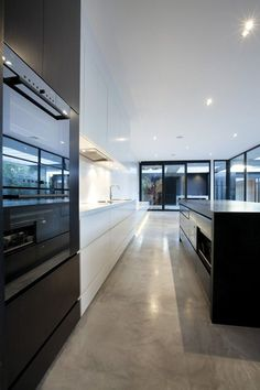 Modern kitchen... Love the white and LOVE the polished cement floor