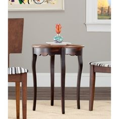 @Overstock - With its tall, elegant legs, this wooden round side table is a stylish addition to any room. Crafted with a scalloped apron and a solid wood top, the table features a narrow, 20-inch diameter design that fits easily between chairs or in small spaces.http://www.overstock.com/Home-Garden/Antiqued-Kailey-Round-Side-Table/4378582/product.html?CID=214117 $107.99