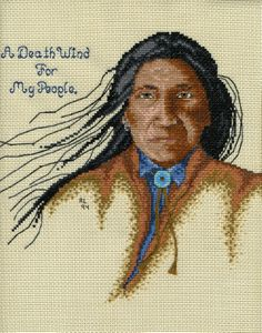 A young Sitting Bull.  I cross stitched this on vinyl-weave 14 count cross stitch fabric for a 3 ring binder cover.