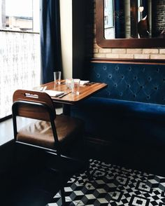 Sapphire Blue Velvet Banquette | Black and White Tile Floor