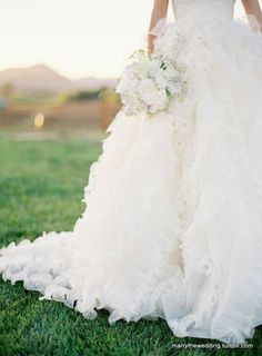 I love how frothy and elegant this dress is, especially with the white flowers.