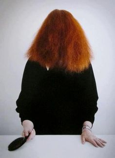 looking for a last minute Halloween Costume? Black dress + red wig + a hair brush = Grace Coddington