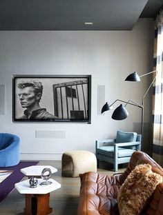 Serge Mouille tripod floor light ca.1950s and Togo sofa by Michel Ducaroy for Ligne Roset (1973). Photograph on the wall of David Bowie by Helmut Newton