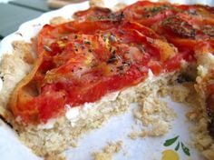 Heirloom Tomato Goat Cheese Tart recipe with a simple olive oil press-in tart crust. The perfect way to savor the season's sweet heirloom tomatoes.