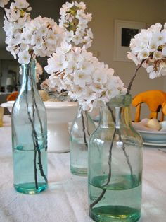 Cottage flowers in vintage bottles ~ dreamy!