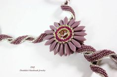 Purple beadweave necklace twisted single strand beaded flower pendant with Swarovski rivoli  czech dagger beads
