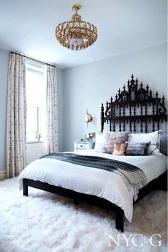 So many light colors wrapped up in such a beautiful space! The coolest thing about this room is the accents, such as the wrought iron headboard and chandelier.