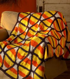 Candy Corn Throw | Crochet a candy corn blanket! Find DIY instructions on joann.com