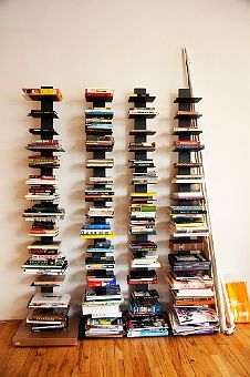 Attention! Books in formation! Always a fan of the spine book case.