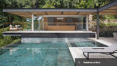 Swoon. Modern geometry w mix of wood w simple white pavers, darker pool interior. Architect Cadas.com.br
