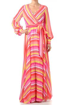 Available on www.lovingme365nyc.com Full length printed dress with front wrap, cuff arms and front tie