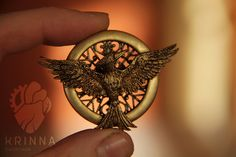 New Mockingjay brooch fom polymer clay by Krinna.deviantart.com on @deviantART