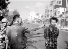 In this Feb. 1, 1968 file photo, South Vietnamese Gen. Nguyen Ngoc Loan, chief of the national police, fires his pistol into the head of suspected Viet Cong officer Nguyen Van Lem, also known as Bay Lop, on a Saigon street, early in the Tet Offensive. AP / Eddie Adams. Taken by Nick Ut (1972)