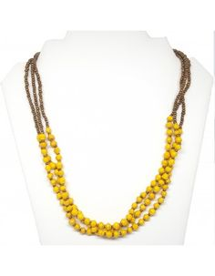 "Triple strand necklace with tiny recycled paper beads strung with gold-colored glass seed beads. Measures 22""."