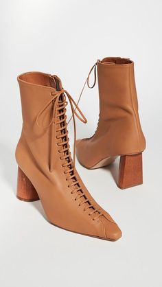 Lace up ankle boots. It's time to dust off your trusted Dr. Martens, because lace up boots are back for another season. Victorian-style slim lace ups ... H&m Boots, White Boots, High Heel Boots, Heeled Boots, Pointed Heels, Buy Shoes Online, Lace Up Booties, Types Of Shoes, Leather Ankle Boots