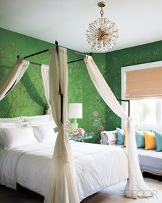 Love the draping of the canopy and how it is tied. The wallpaper is fab too.